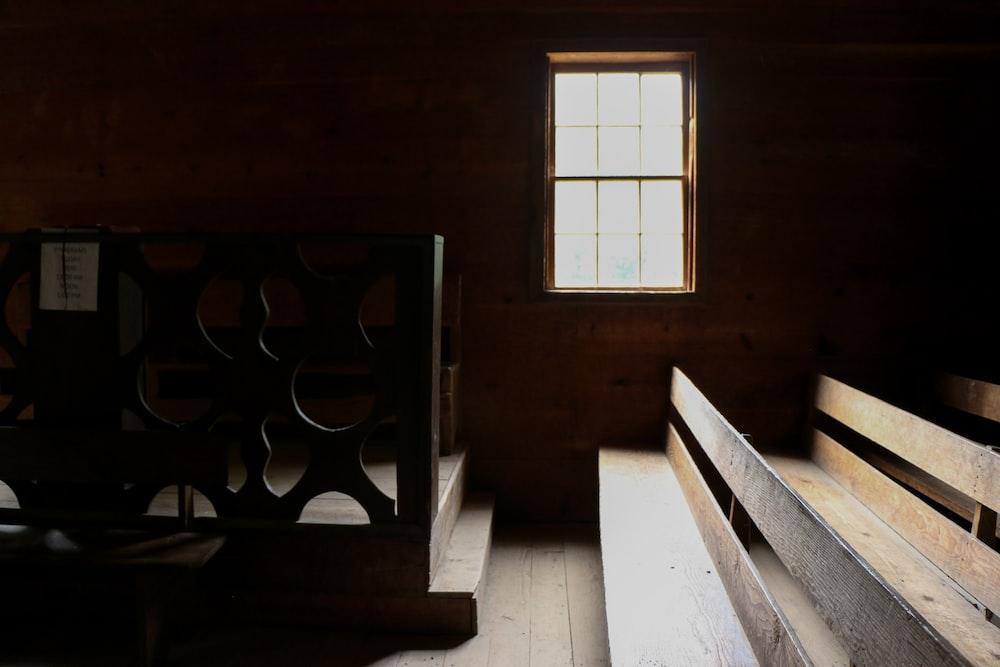 brown wooden door near white wooden table