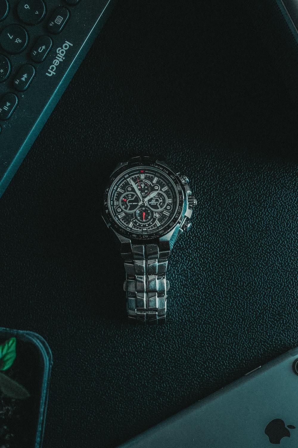 silver link bracelet round chronograph watch