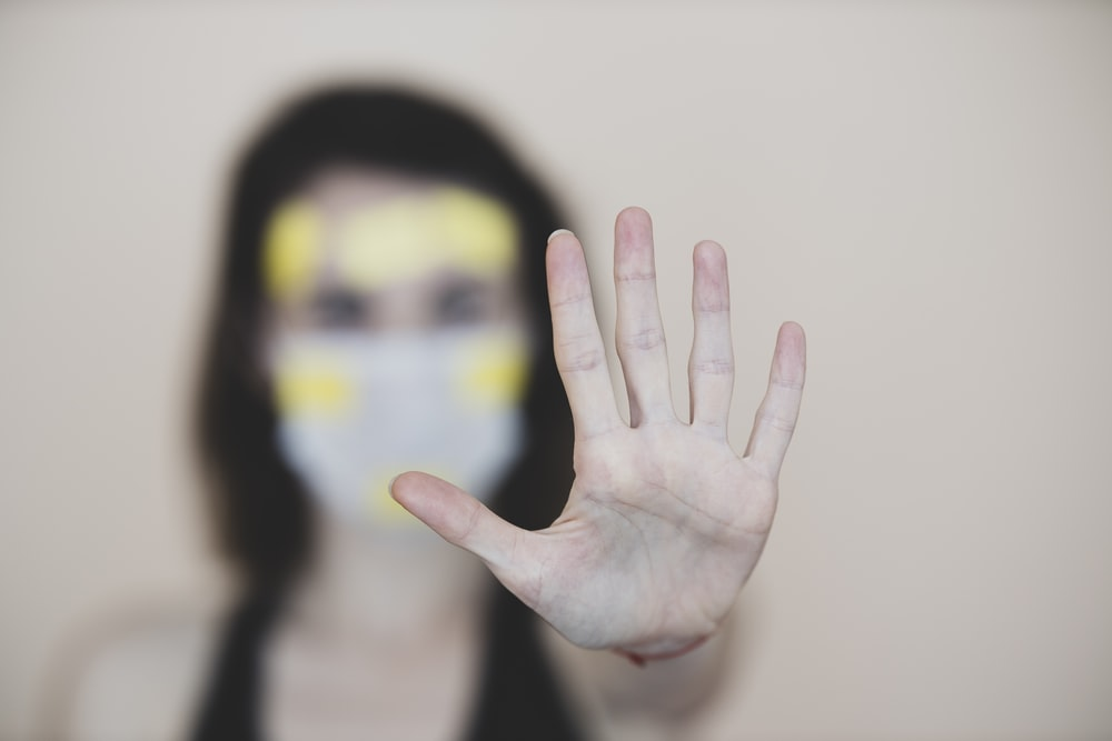persons hand with yellow and black paint