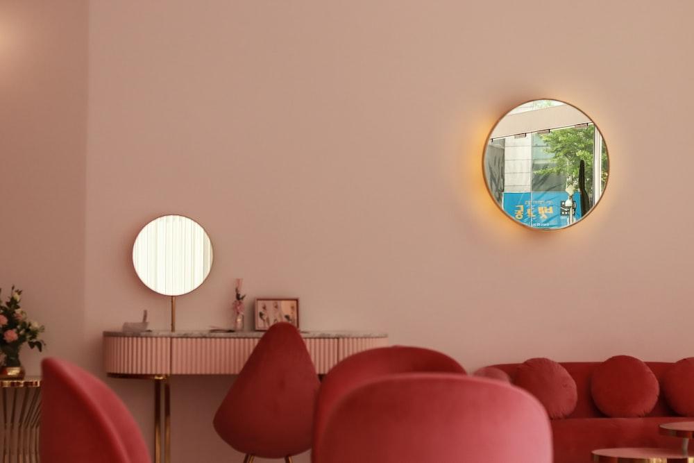 red sofa near round mirror