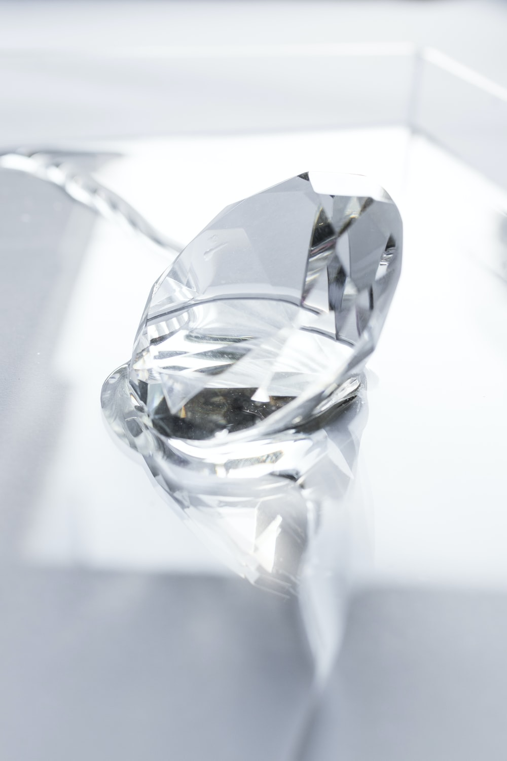 clear crystal on white surface