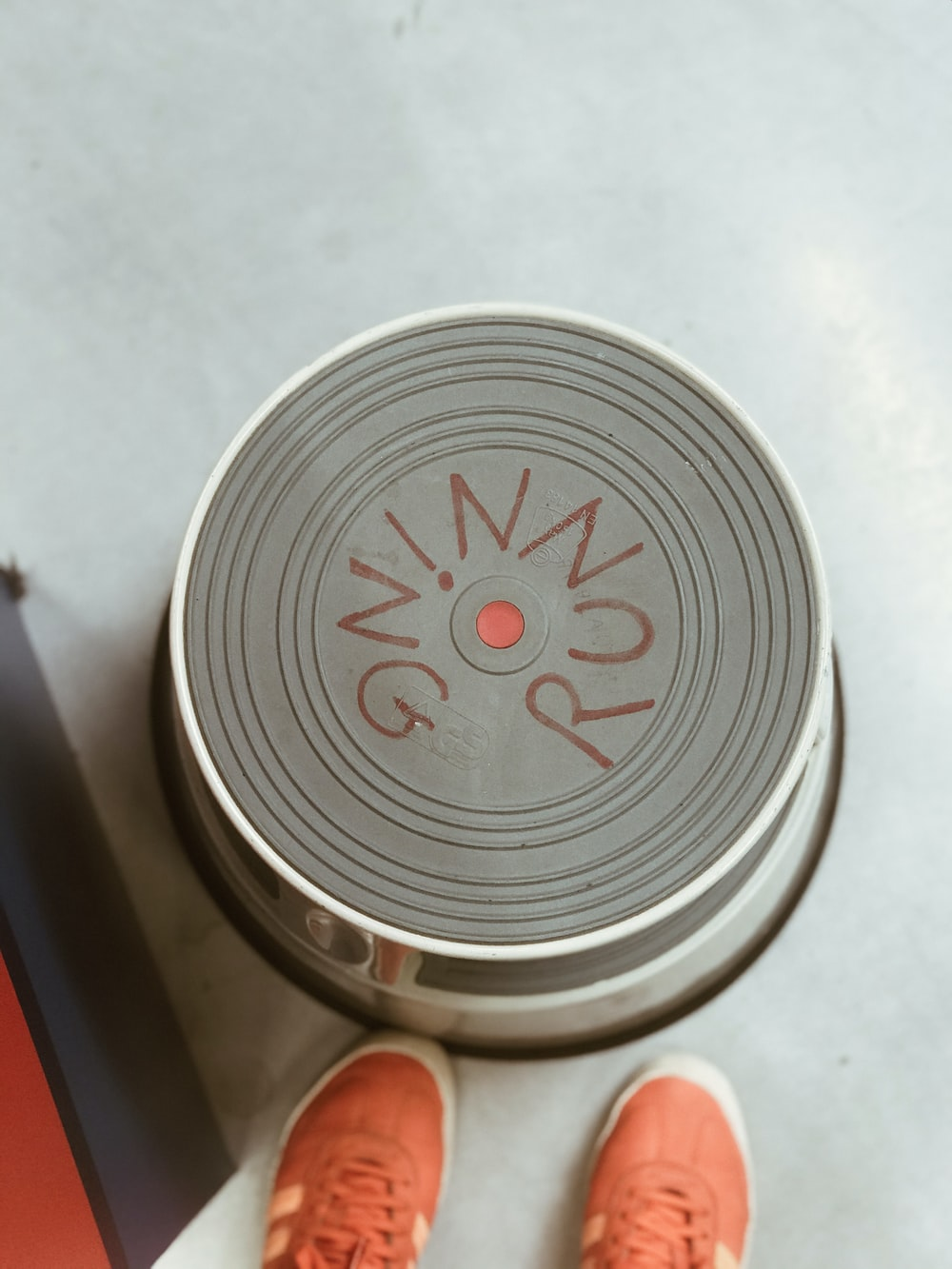 silver can on white table
