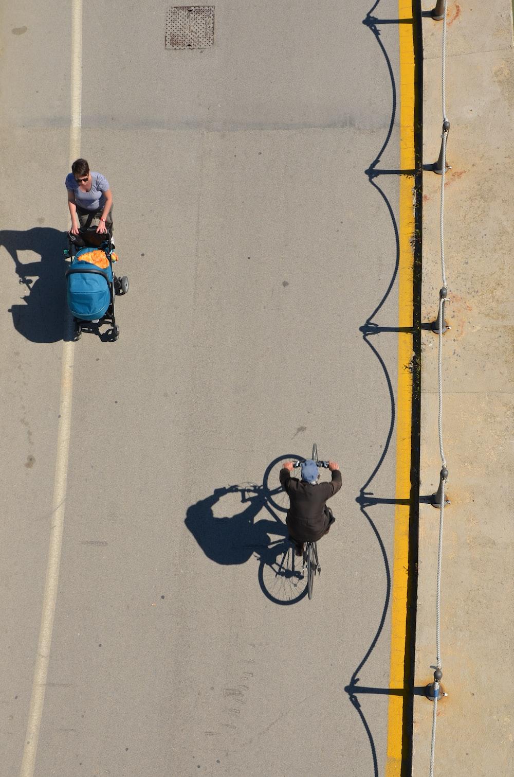 man in blue shirt riding bicycle