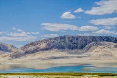 brown and white mountain under blue sky during daytime tajikistan zoom background