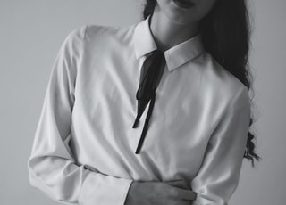 woman in white long sleeve shirt