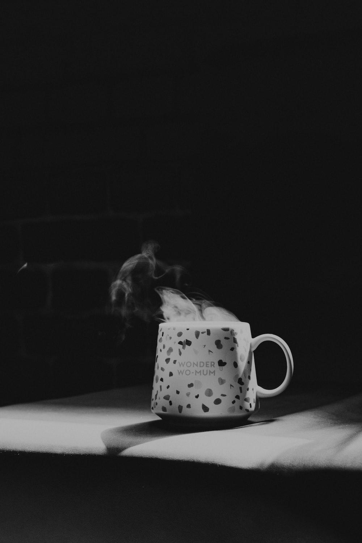 grayscale photo of white ceramic mug