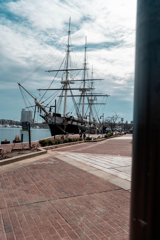 black ship on dock during daytime
