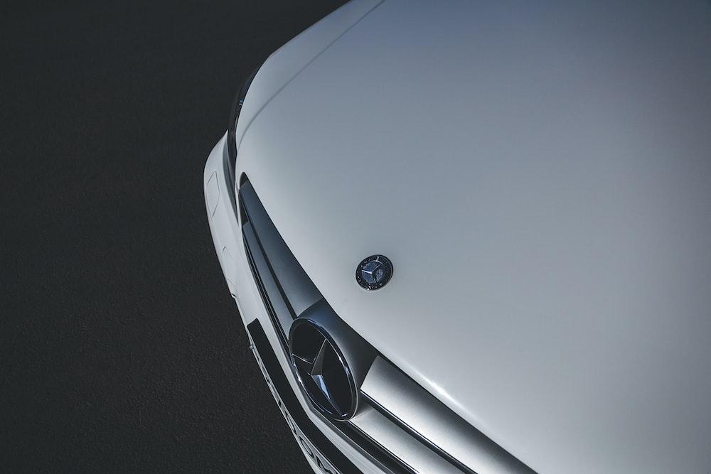 white mercedes benz car on black asphalt road