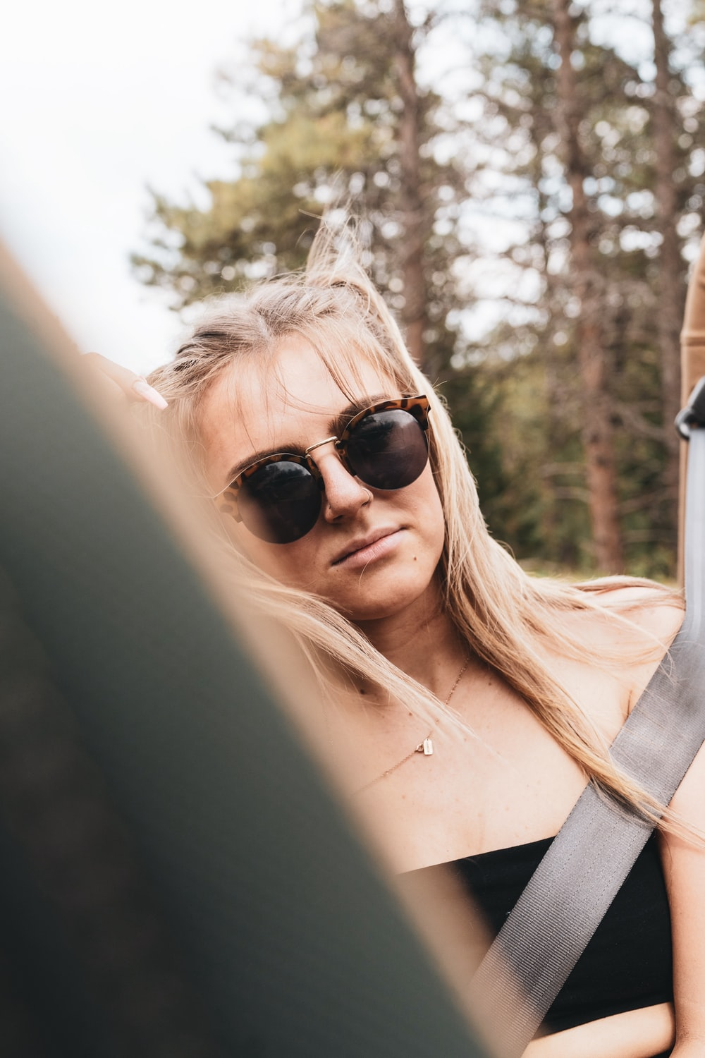 woman in black sunglasses and white shirt