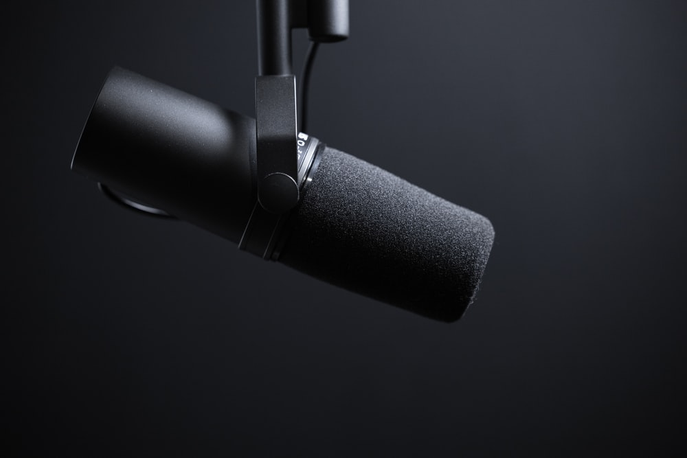 black and silver microphone with white background