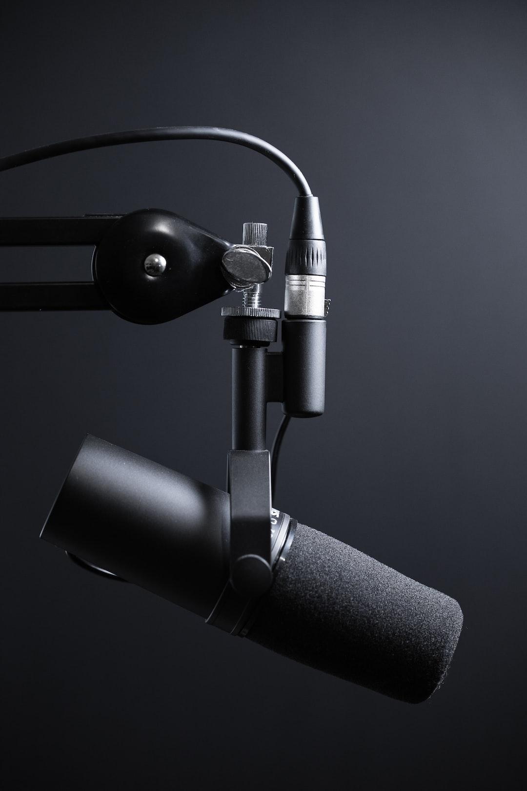 "Black podcasting microphone on arm. Please consider crediting ""Image: Jukka Aalho / Kertojan ääni"" and linking to https://ker"