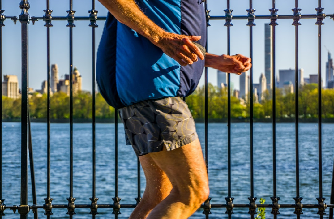 A man jogging around the reservoir in Central Park in spring.