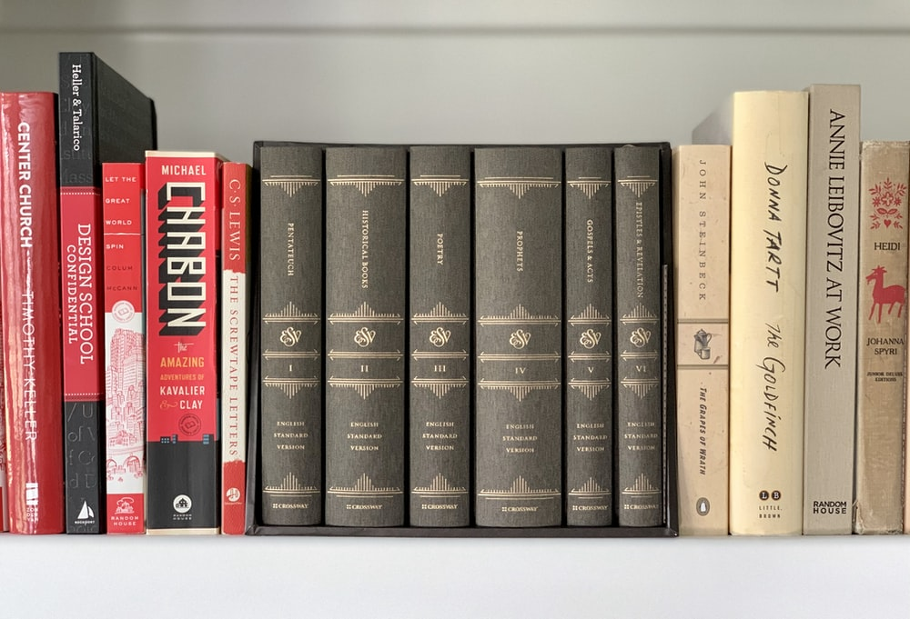 black and red books on white shelf