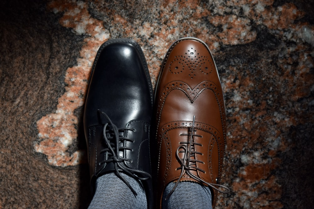 person wearing brown leather shoes
