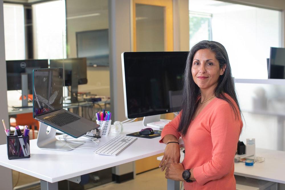 woman in orange long sleeve shirt sitting on chair