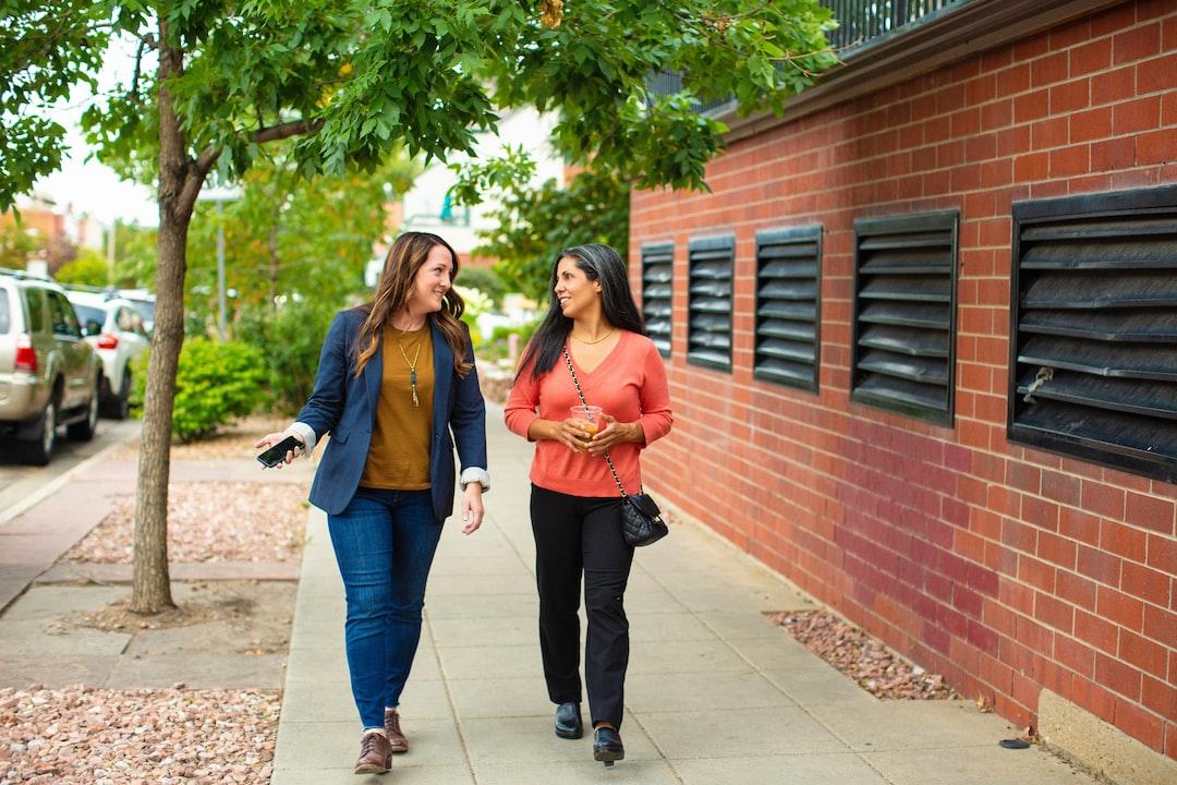 Two women walking outside talking