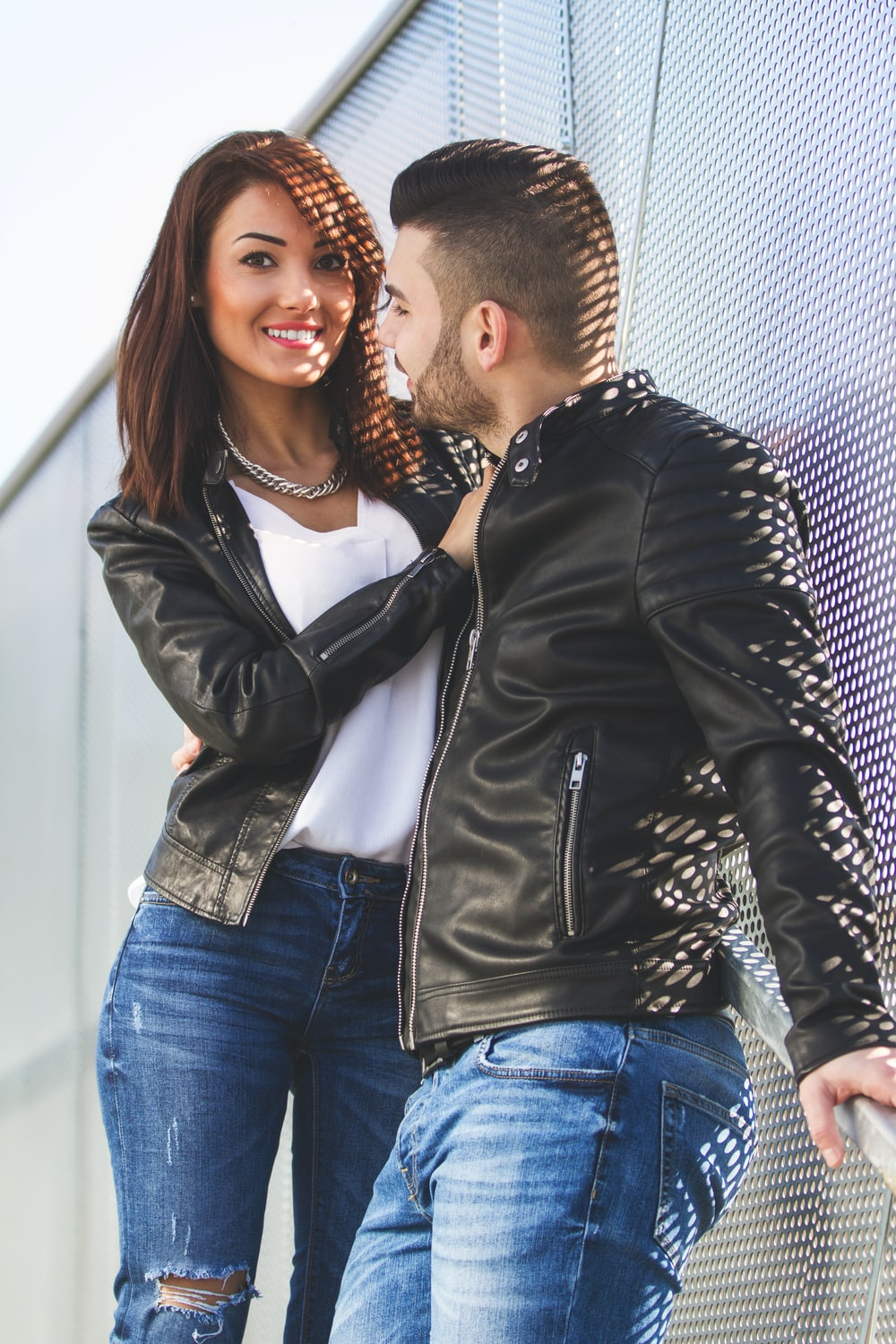 woman in black leather jacket and blue denim jeans