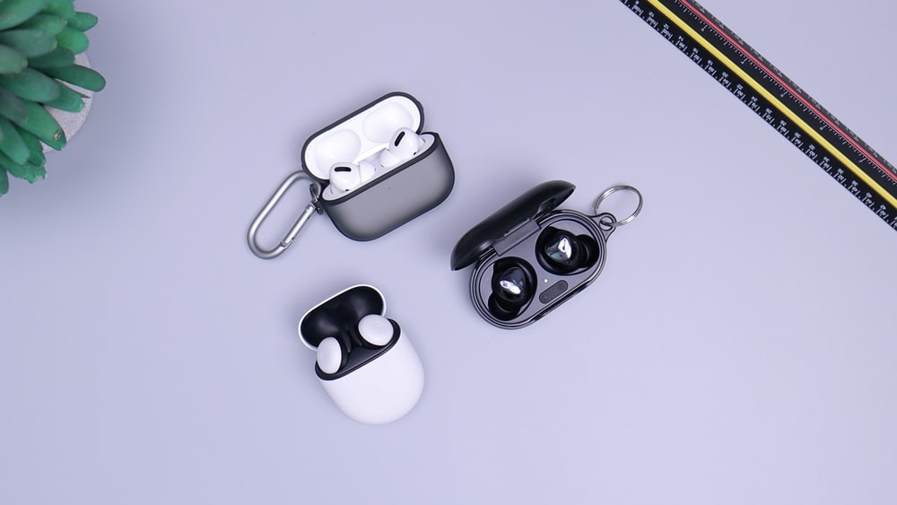 black and white headphones on white table