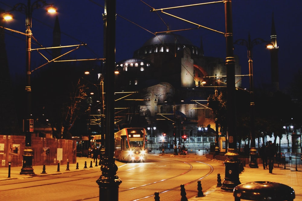 black street light near white concrete building during night time