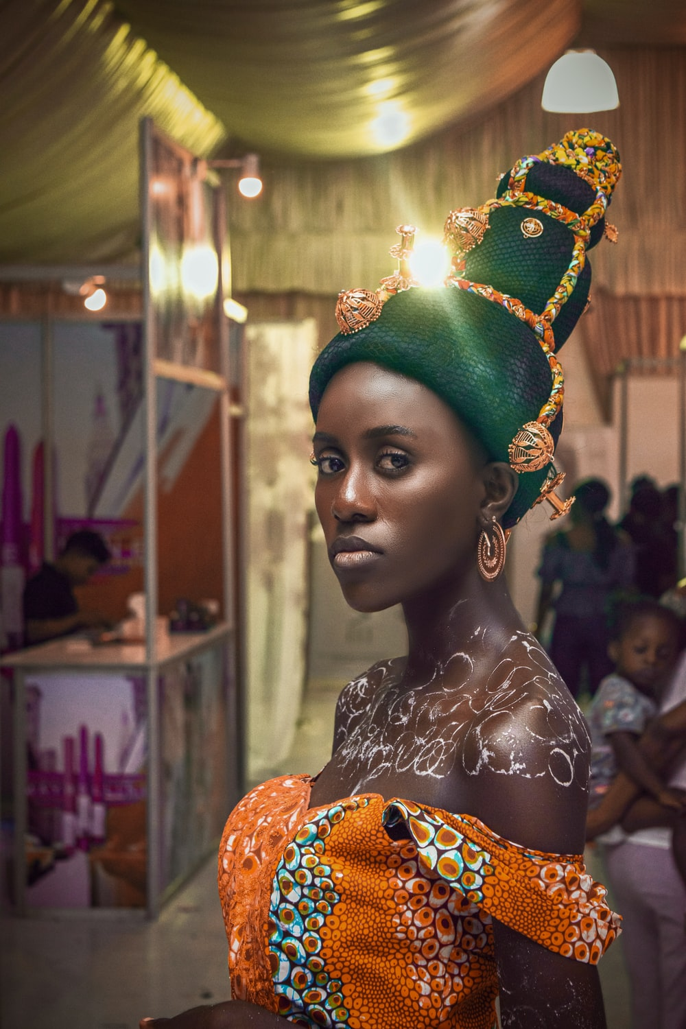 woman in green and gold crown