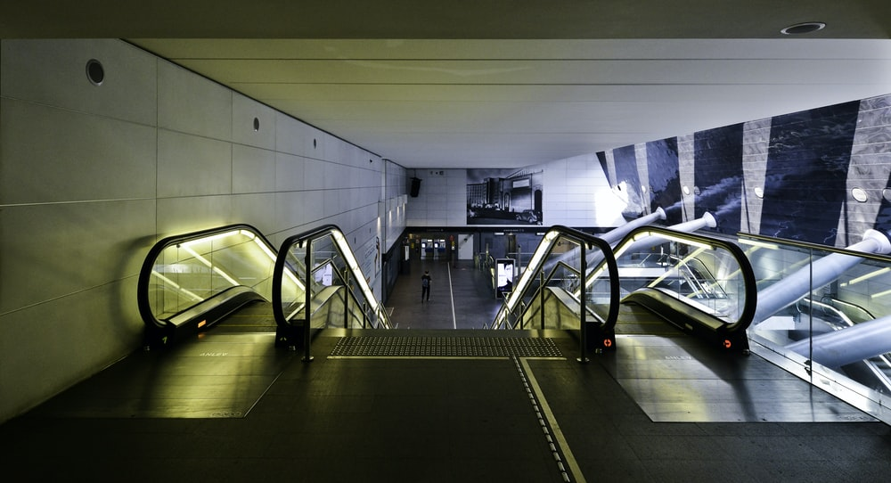 black and white escalator inside building