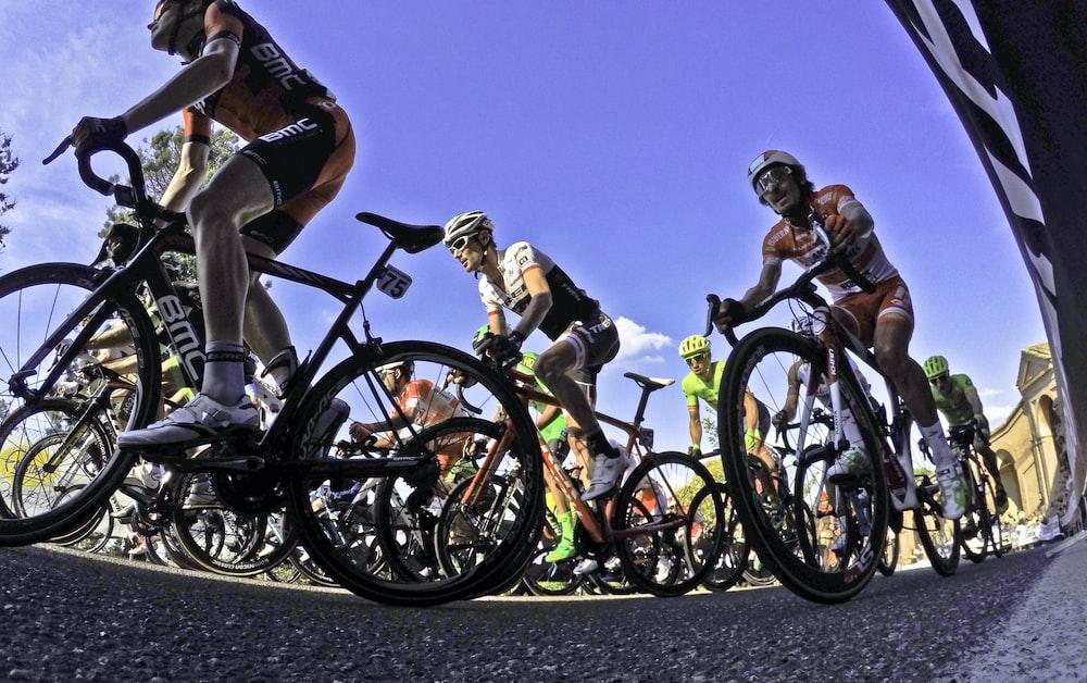 people riding on mountain bikes during daytime