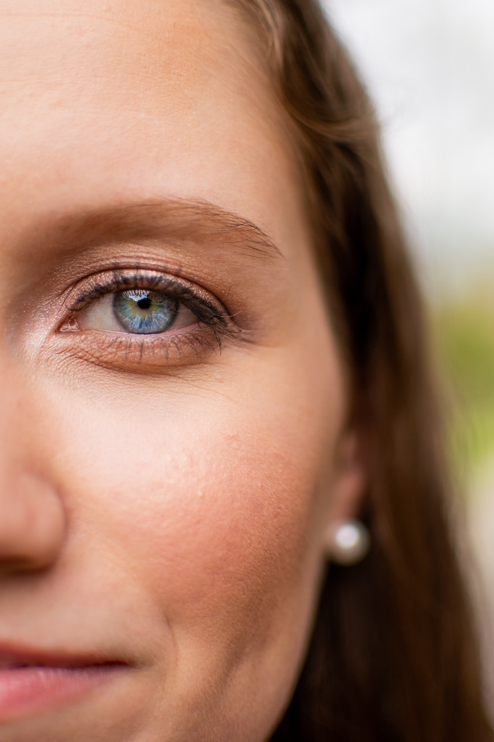 Woman With Blue Eyes And Silver Nose Piercing Photo Free Human