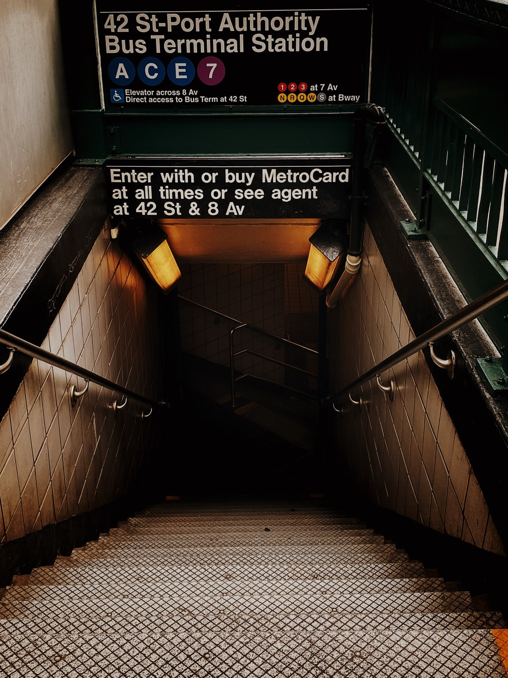 black and white staircase with green and yellow wooden signage