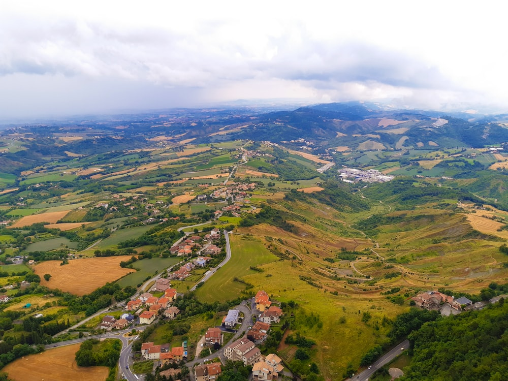 aerial view of green and brown mountains during daytime