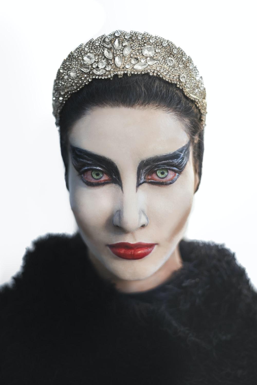 woman in black fur top wearing gold crown