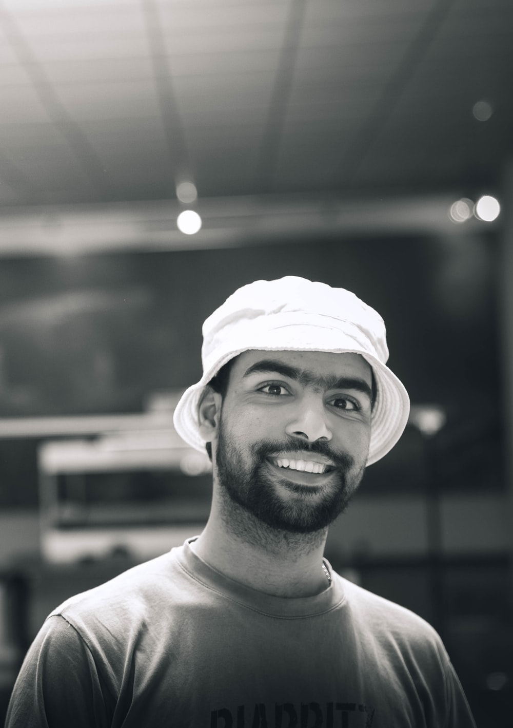 man in white crew neck shirt smiling