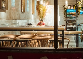 brown wooden bar counter with brown wooden stools