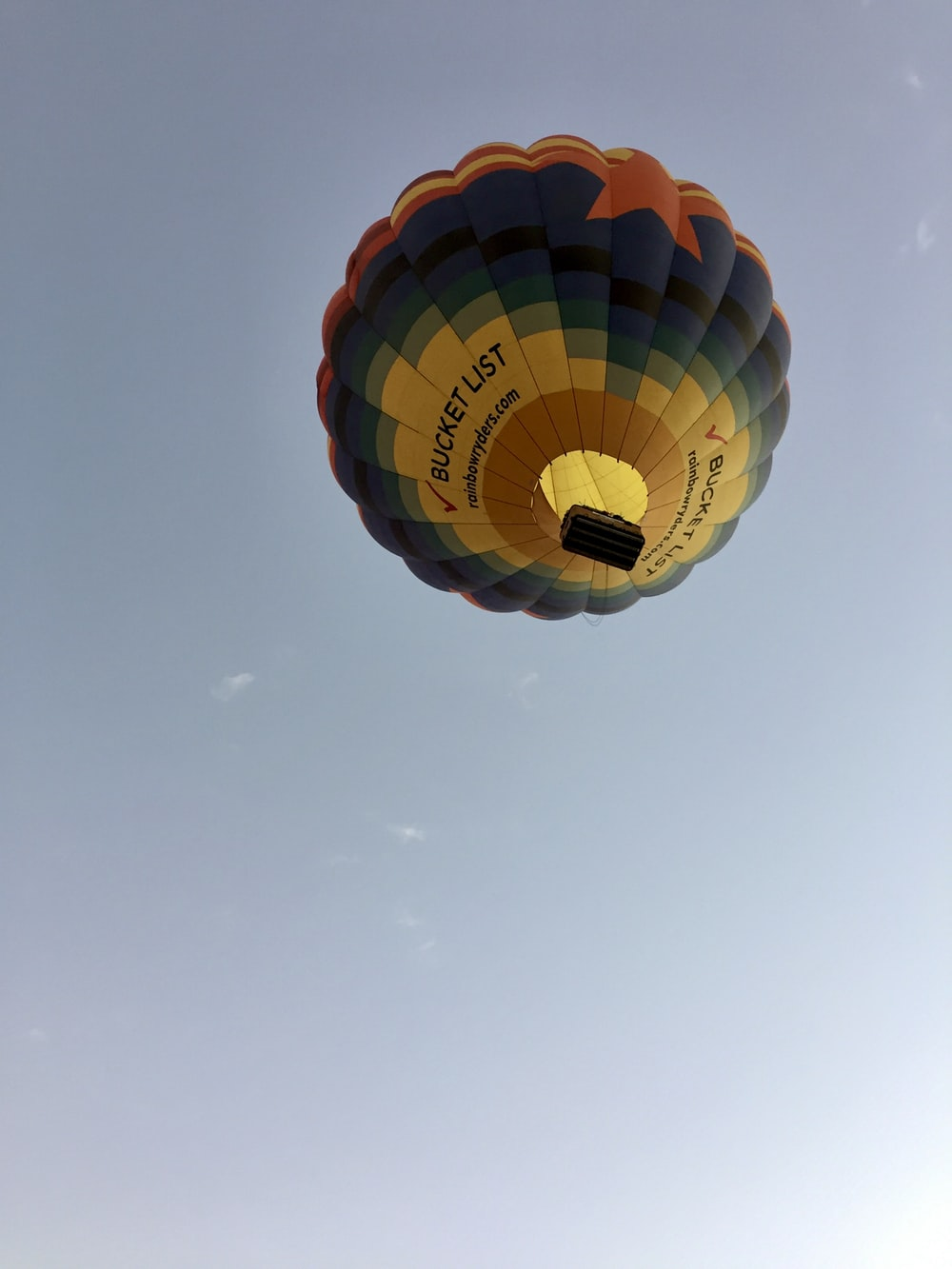 blue red and yellow hot air balloon in mid air