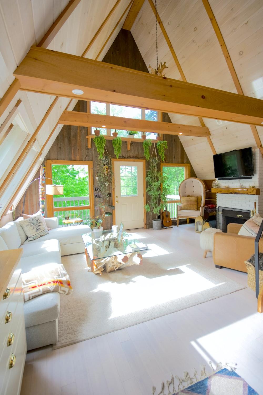 white couch near brown wooden door