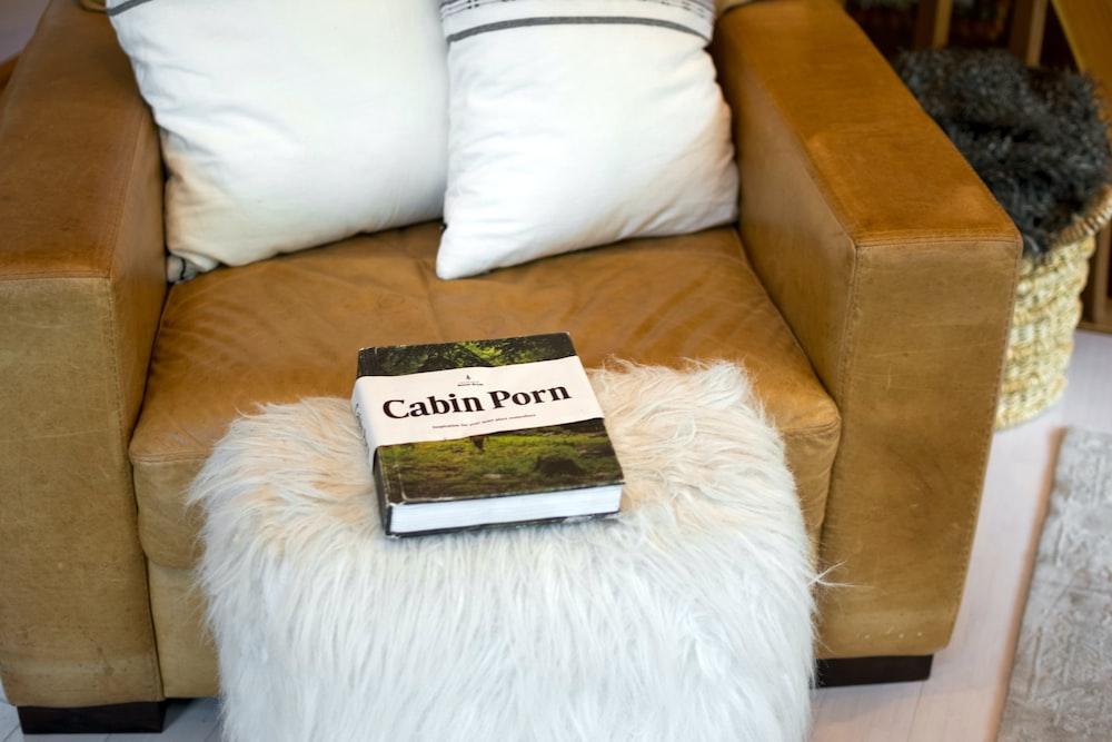 black and white book on white fur textile