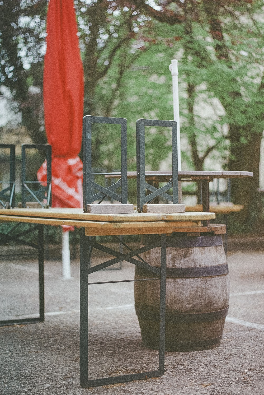brown wooden table with green and red chairs