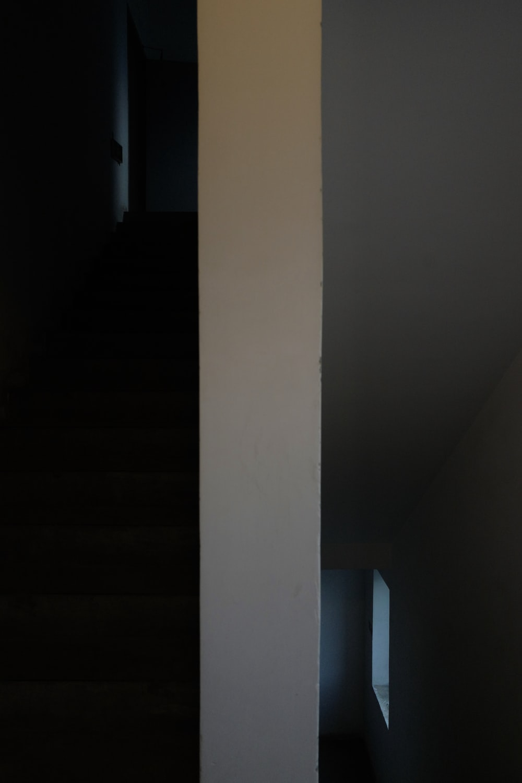 white concrete pillar near white wall