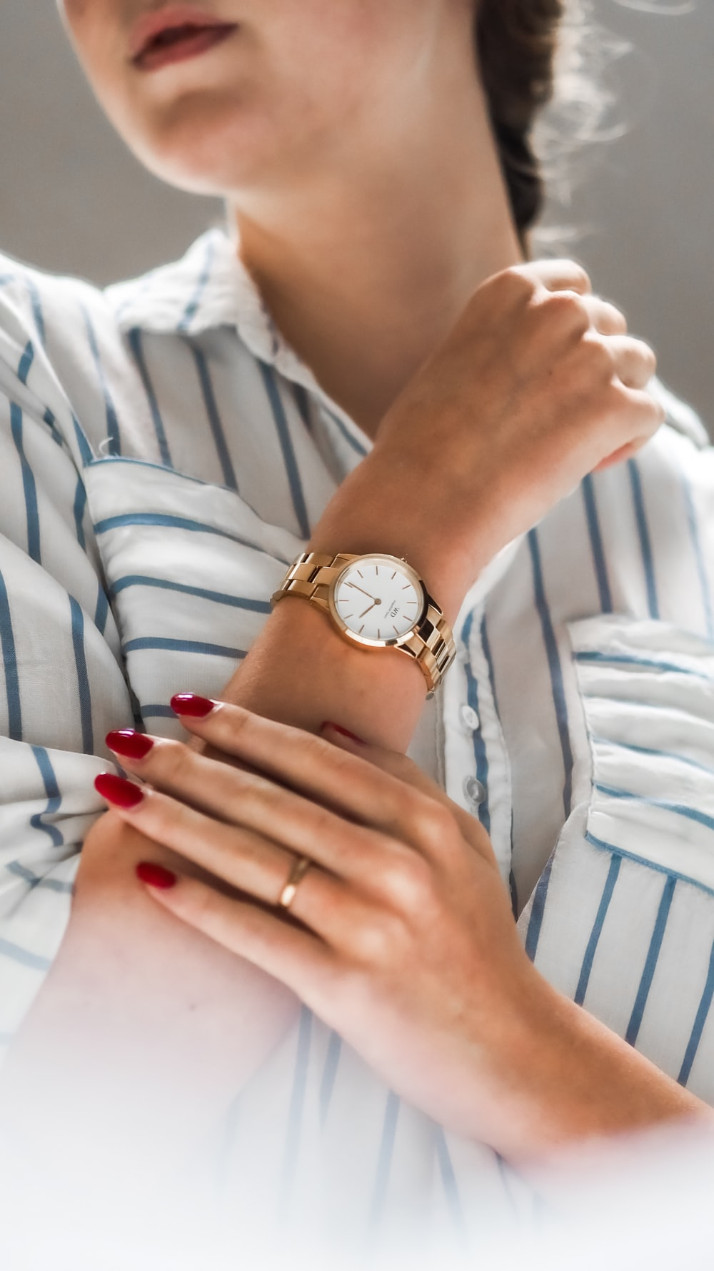 person wearing silver and gold analog watch