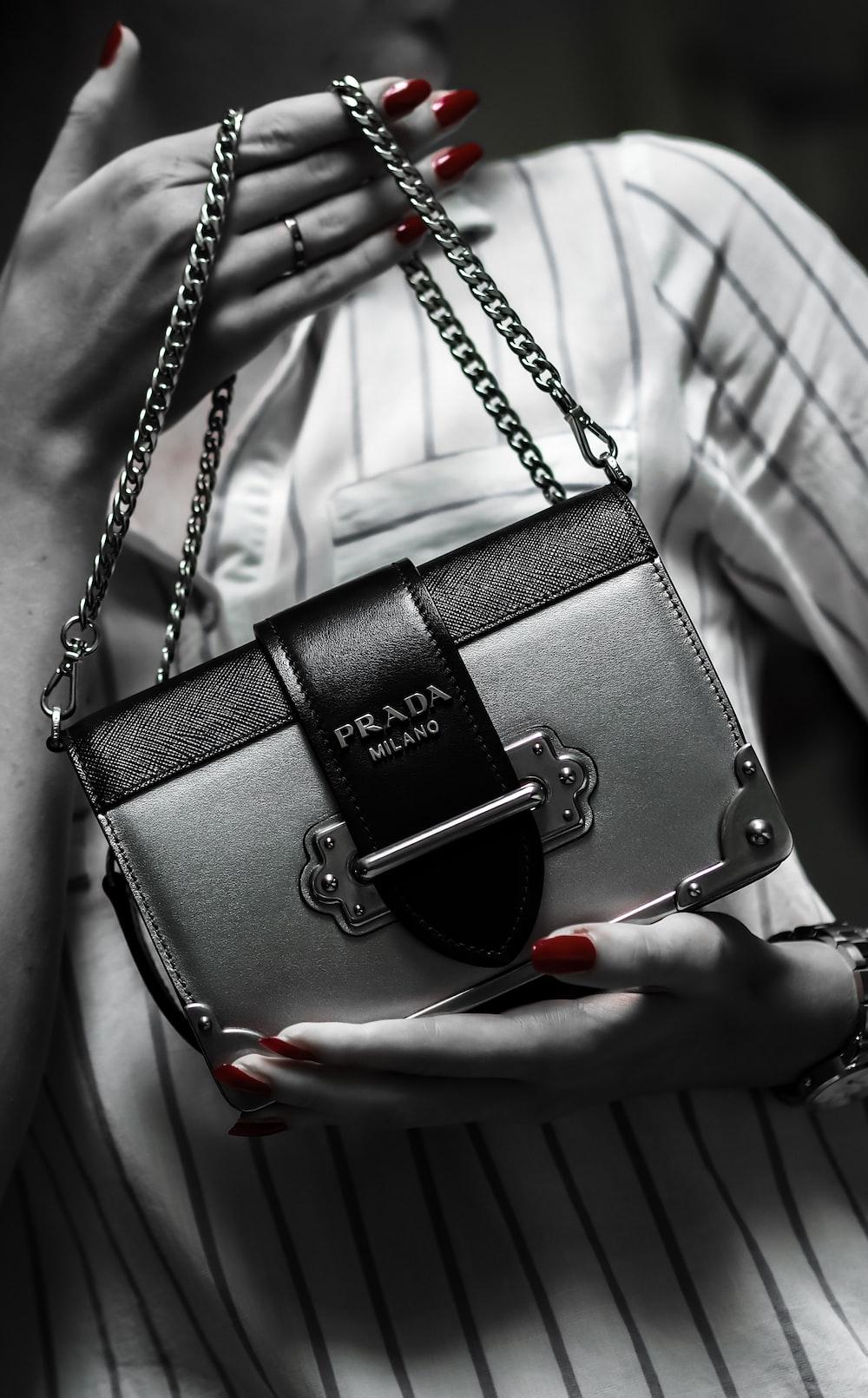 black leather handbag on white textile