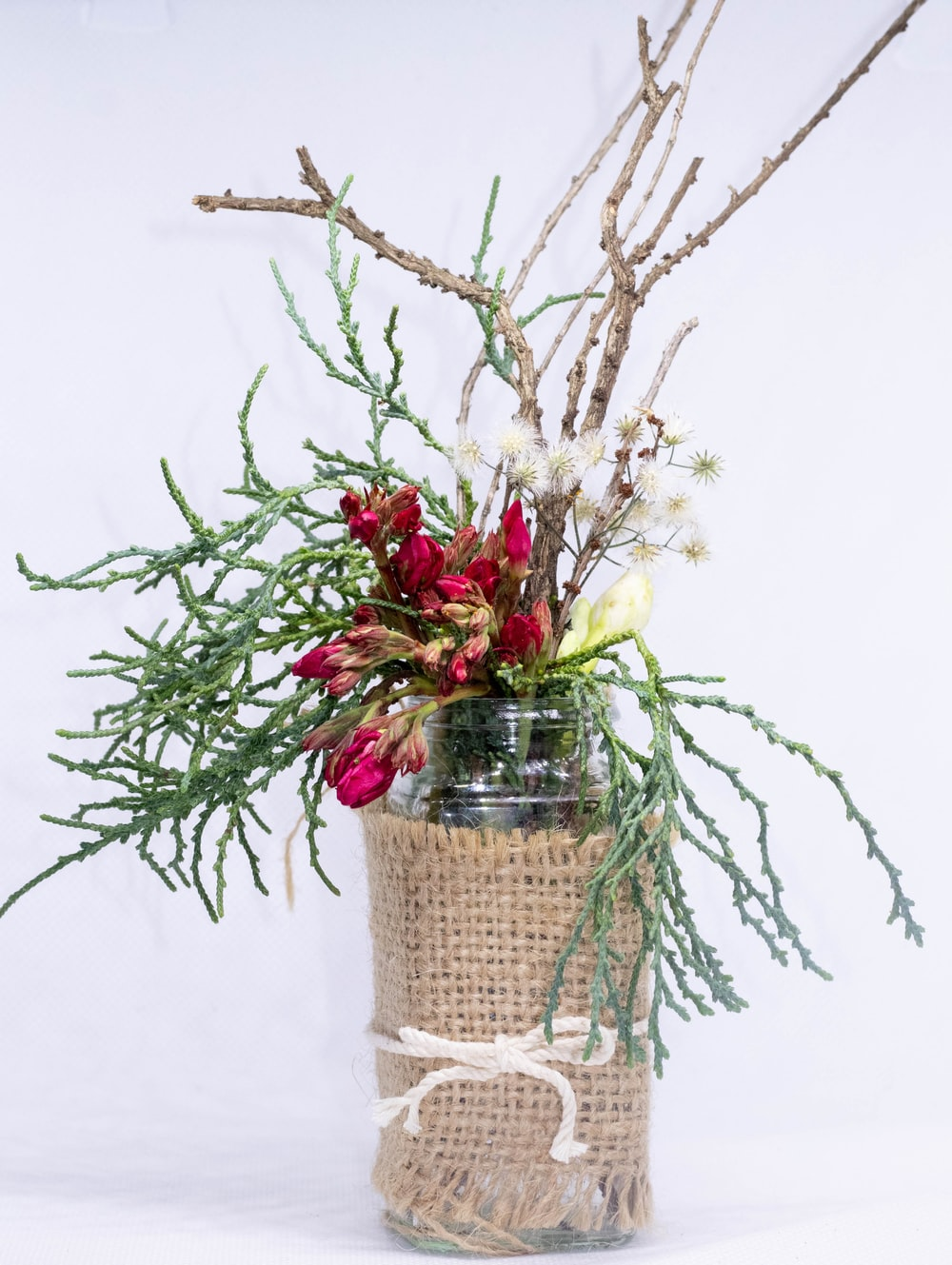 red and yellow roses in brown wicker basket