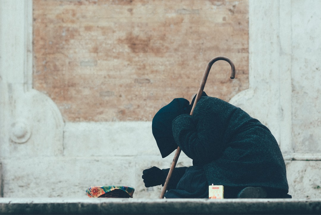 A beggar on the steps of the temple.