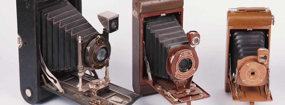brown and black camera on white surface