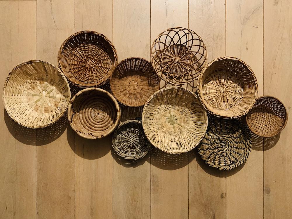 brown woven round baskets on brown wooden floor