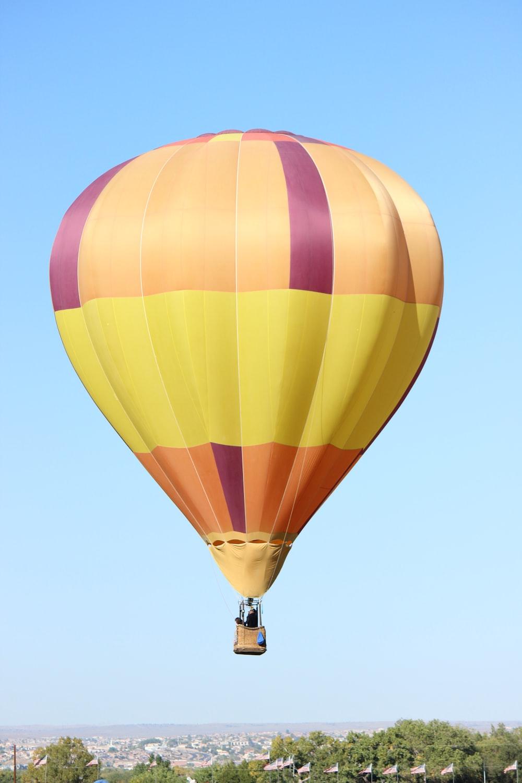 yellow blue and pink hot air balloon