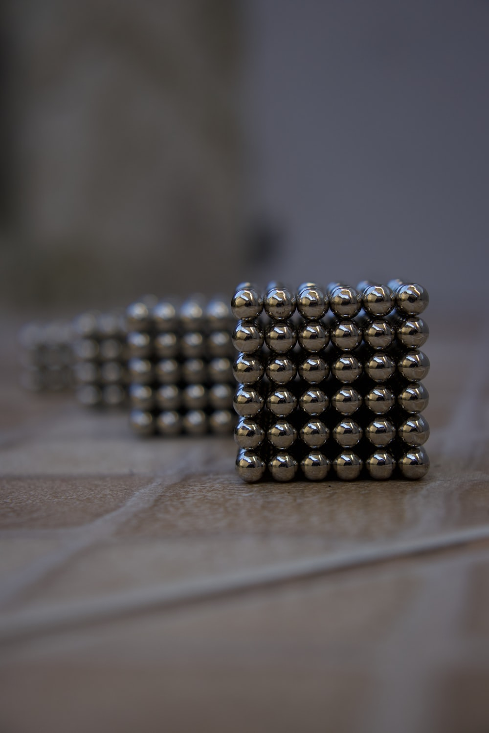 silver beads on brown wooden table