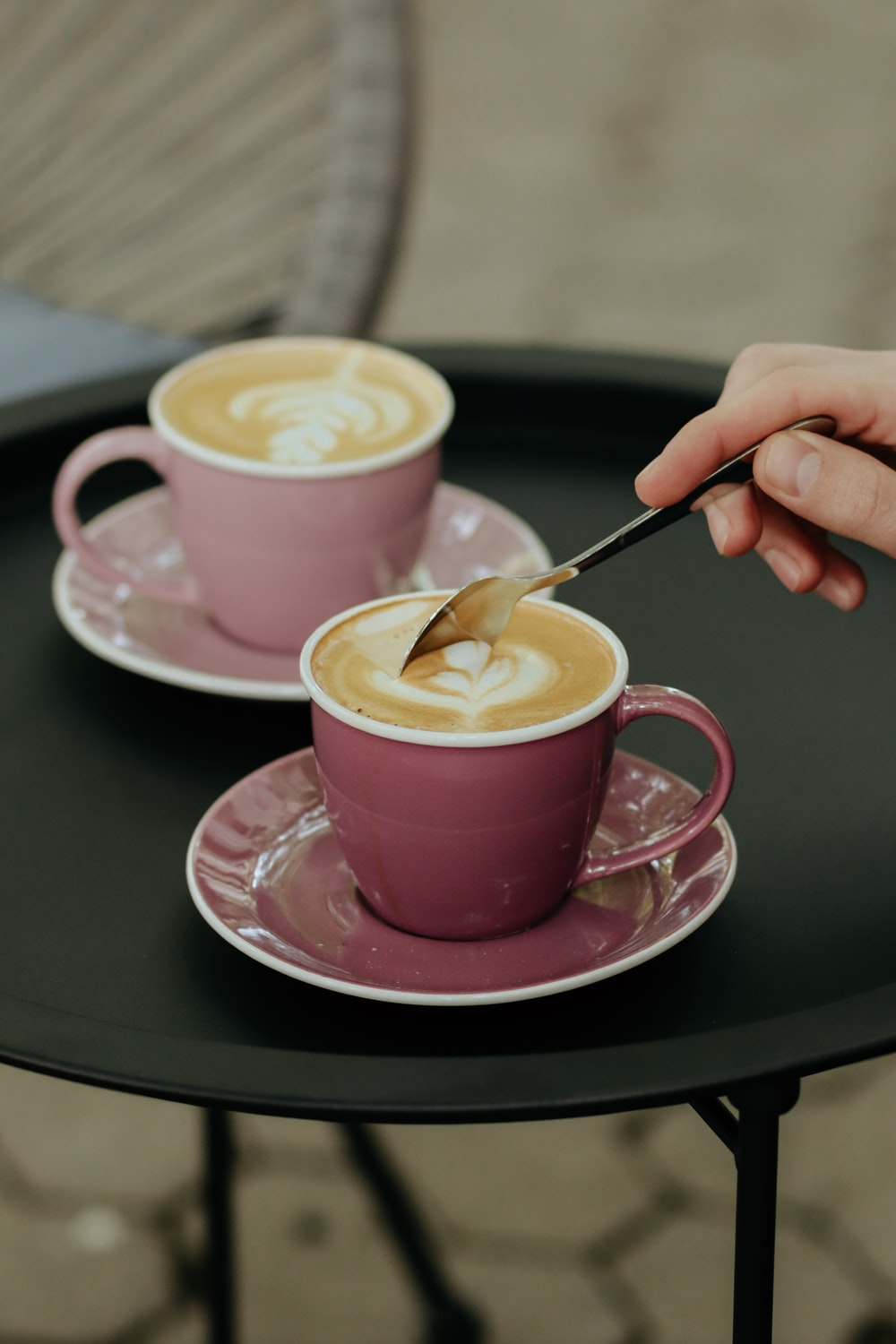 pink ceramic cup with saucer and spoon