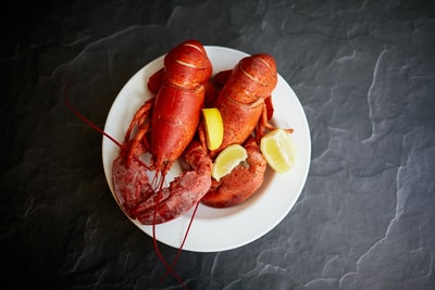 red lobster on white ceramic plate lobster teams background