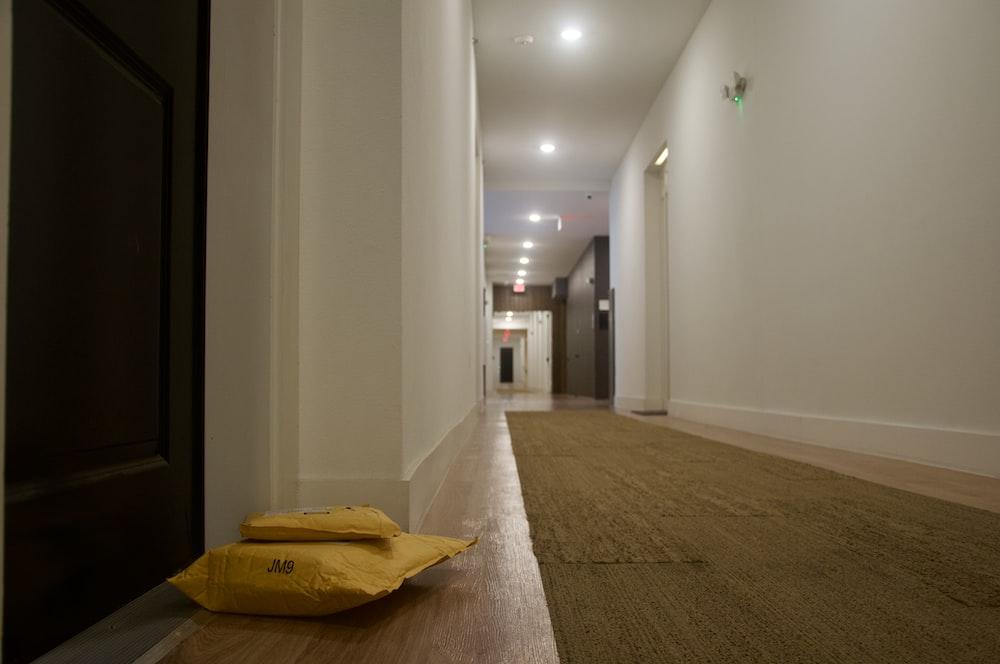 yellow plastic bag on brown carpet