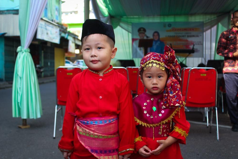 2 children in red long sleeve shirt