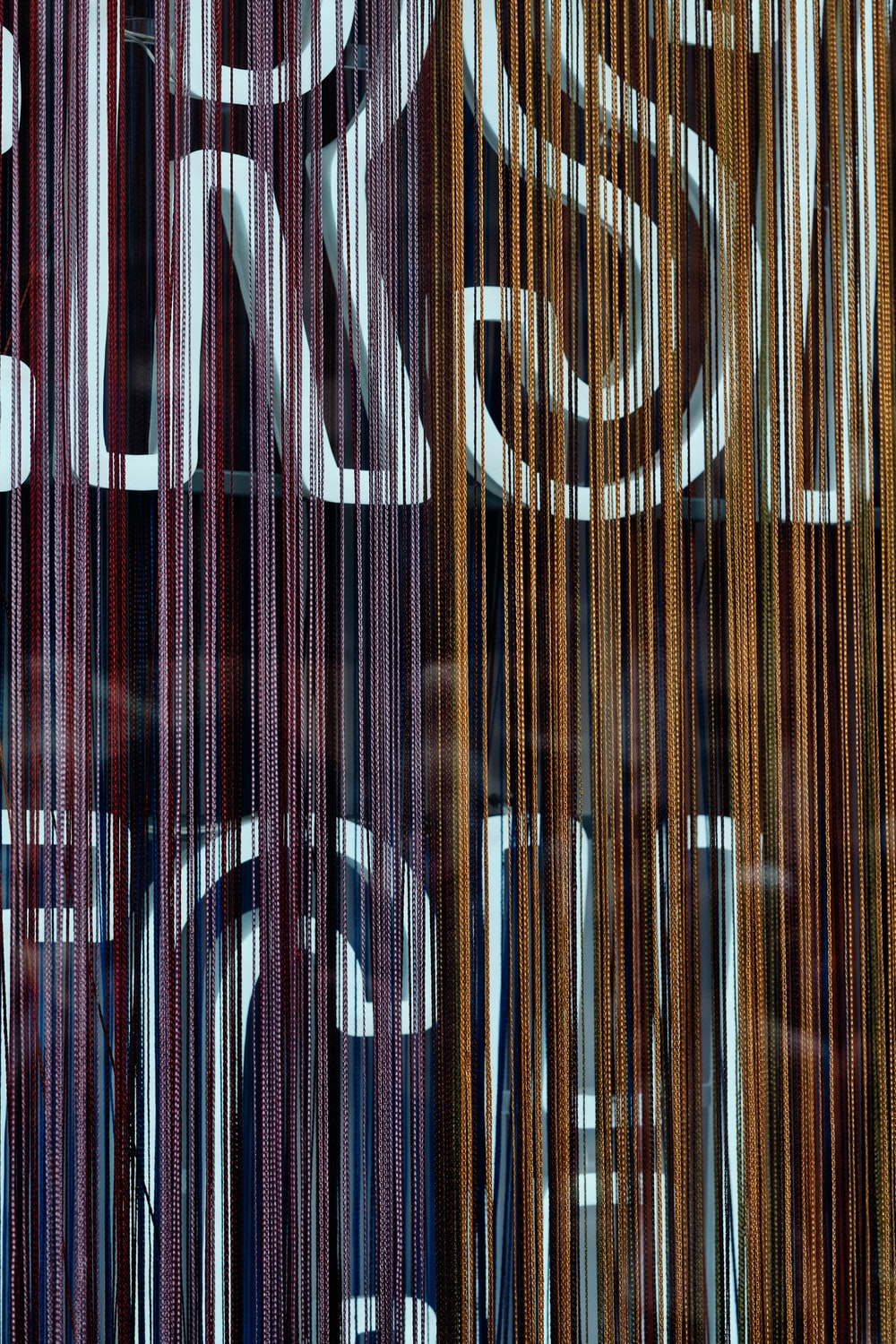 brown and black striped textile